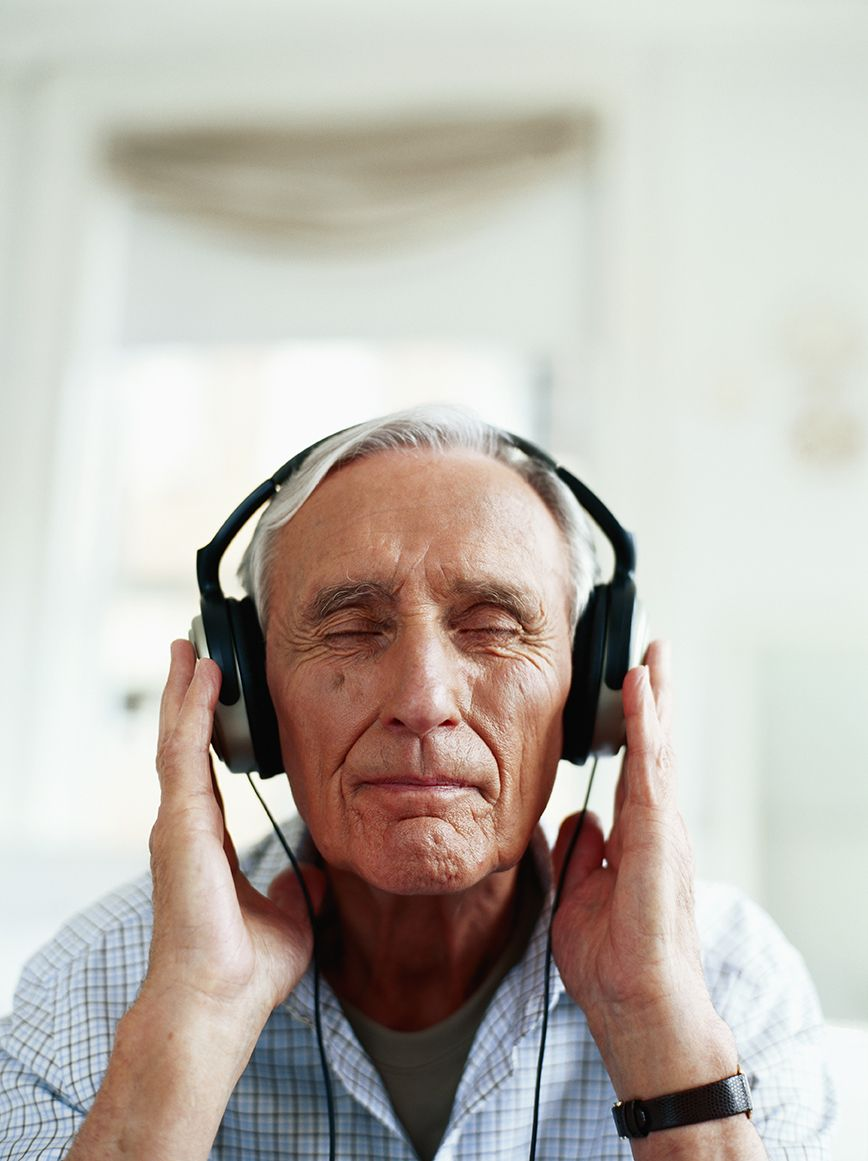 Elderly man with headphones on and eyes closed - El Paso TX