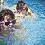 Kids wearing sunglasses and playing in a pool - El Paso TX