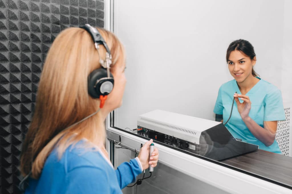 doctor and patient during hearing test