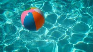 A beachball floating in a pool.